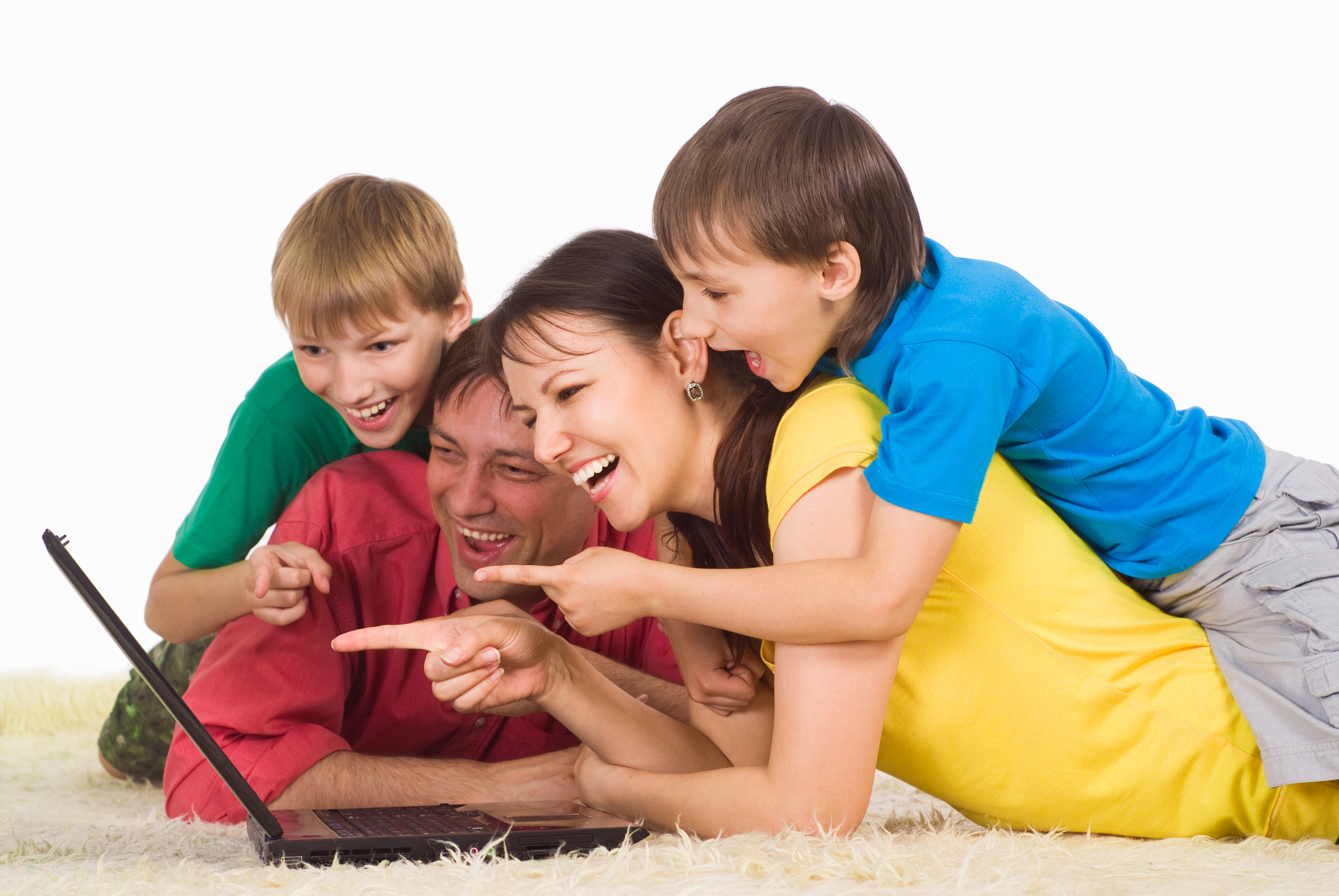 cute family lying on a carpet with laptop